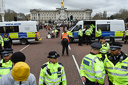 © Licensed to London News Pictures. 15/03/2019. LONDON, UK. Police manage marchers around Buckingham Palace. Thousands of students take part in a Climate Change strike in Parliament Square, marching down Whitehall to Buckingham Palace.  Similar strikes by students are taking part around the world demanding that governments take action against the effects of climate change.  Photo credit: Stephen Chung/LNP