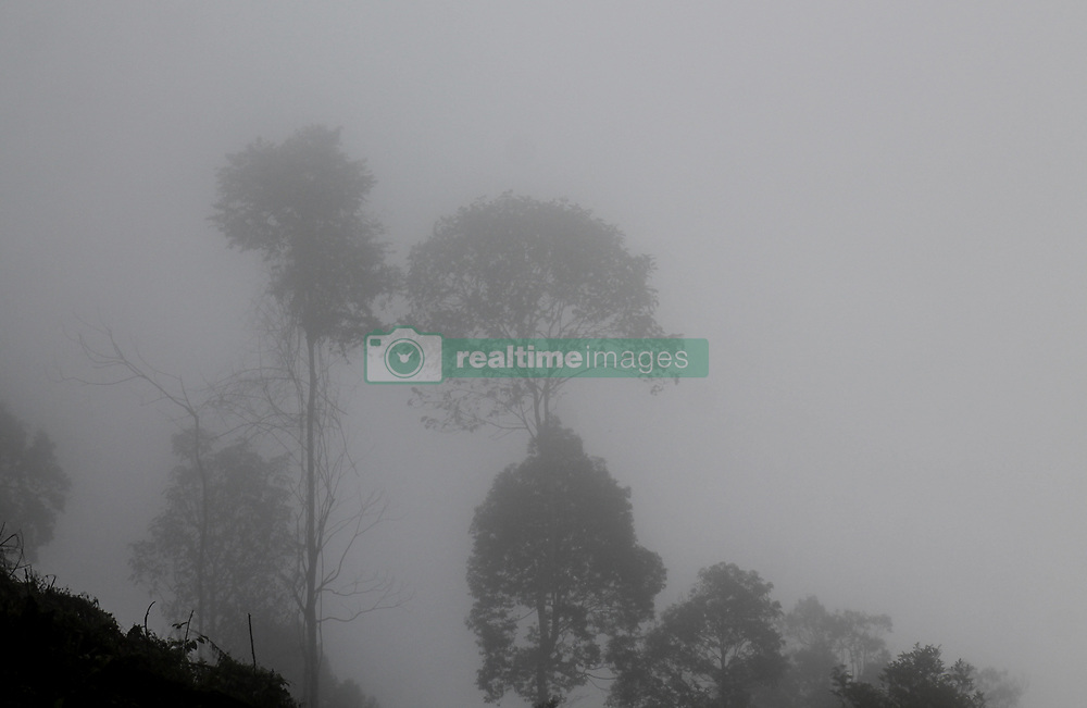 January 29, 2018 - Bener Meriah, Aceh, Indonesia - A view of thick fog was seen during the afternoon, on the mountains road of North Aceh - Bener Meriah, Aceh Province, Indonesia on January 30, 2018. The thick fog often causes traffic delays and several traffic accidents in the area. (Credit Image: © Fachrul Reza/NurPhoto via ZUMA Press)
