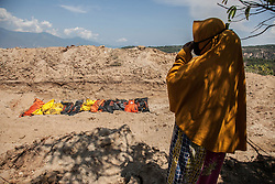 October 3, 2018 - Palu, Central Sulawesi, Indonesia - Susanti, a tsunami survivor seeing in the shade of a near a mass burial field where her husband was buried, after earthquake and tsunami on September 28. Indonesian government on October 2 said the death toll from a devastating quake-tsunami on the island of Sulawesi had risen to 1,234 people, up from the previous count of 844 have been confirmed dead slammed into Indonesia's coastline on the island of Sulawesi, causing thousands of homes to collapse, along with hospitals, hotels and shopping centers. Emergency services fear that the death toll could rise into the thousands as rescue teams made contact with the nearby cities of Donggala and Mamuju and strong aftershocks continue to rock the city. (Credit Image: © Ivan Damanik/ZUMA Wire)