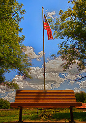 Happy 4th of July. My tribute to Independence day this year. Old Glory flying behind a bench at a roadside rest stop in Minnesota