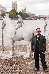 "© Licensed to London News Pictures. 02/09/2015 London, UK. The art installation entitled ""The Rising Tide"" (comprising four horse-riders on horses with petroleum pumps for heads) by the underwater eco-sculptor Jason deCaires Taylor (pictured), stands on the foreshore of the River Thames in Vauxhall and is revealed with each low tide.  The installation aims to question man's reliance on fossil fuels and is part of this year's Totally Thames festival. Photo credit : Stephen Chung/LNP"