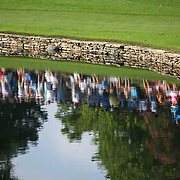 CHARLOTTE, NC - August 10, 2017:  Fans can be seen reflected in the pond off 17 on the first day of the 2017 PGA Championship at Quail Hollow Club. CREDIT: LOGAN R. CYRUS FOR CHARLOTTE MAGAZINE