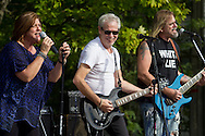 """Monroe, New York - The band """"White Lie"""" plays at a benefit concert to save the plane at Airplane Park on Sept. 7, 2013. The concert was held in the parking lot of the Bourbon Street Bar and Grill. The the Korean War era F-86L jet was in danger of being removed from the park."""