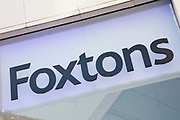 Sign for estate agent Foxtons in London, United Kingdom.