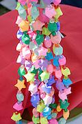 Decorative necklaces on concession table. Dragon Festival Lake Phalen Park St Paul Minnesota USA