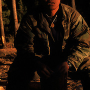 Laotian immigrant Laae Vongsaly and his family harvest matsutake mushrooms in the Willamette National Forest of Oregon. More than 2,000 pickers participate in the matsutake mushroom harvest during October and November. Most of the pickers are immigrants from Laos, Cambodia, Vietnam, China and Japan. Please contact Todd Bigelow directly with your licensing requests.