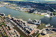 Nederland, Noord-Holland, Amsterdam, 14-06-2012; Zicht op het IJ met Westerdok en Amsterdam-Noord. Westerdoksdijk, Westerdok, Stenen Hoofd en Silodam. Op het kunstmatige schiereiland IJDock, toekomstige huisvesting van onder andere het Gerechtshof van Amsterdam, Dienst Waterpolitie van het Korps Landelijke Politiediensten (KLPD). Het nieuwe filmuseum Eye staat rechtsmiddden in beeld...View on the IJ (water)  and the north bank Amsterdam North (top picture) . Urban renewal in Amsterdam West and North, mainly residential houses, but  for creative entreprises. The home offices for the Amsterdam Court of appeal and the police are constructed on a artificial isle. New construction film museum Eye (m, r) luchtfoto (toeslag), aerial photo (additional fee required).foto/photo Siebe Swart