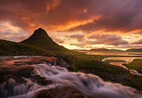 Mt Kirkjufell and kirkjufellfoss and dramatic sunrise light, Iceland