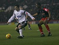 John Macken of Derby bCounty holds the ball up against Stoke City