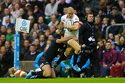 England Full Back (#15) Mike Brown (Harlequins)  is tackled by Argentina Inside Centre (#12) Santiago Fernandez (Bayonne) during the first half of the match - Photo mandatory by-line: Rogan Thomson/JMP - Tel: Mobile: 07966 386802 09/11/2013 - SPORT - RUGBY UNION -  Twickenham Stadium, London - England v Argentina - QBE Autumn Internationals.