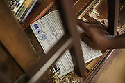 A woman hands her prescription to pharmacy staff at the Koumassi General hospital in Abidjan, Cote d'Ivoire on Friday July 19, 2013.