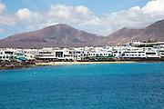Sandy beach and buildings in Playa Blanca, Lanzarote, Canary Islands, Spain