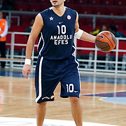 Anadolu Efes's Kerem TUNCERI during their Two Nations Cup basketball match Anadolu Efes between Panathinaikos at Abdi Ipekci Arena in Istanbul Turkey on Saturday 01 October 2011. Photo by TURKPIX