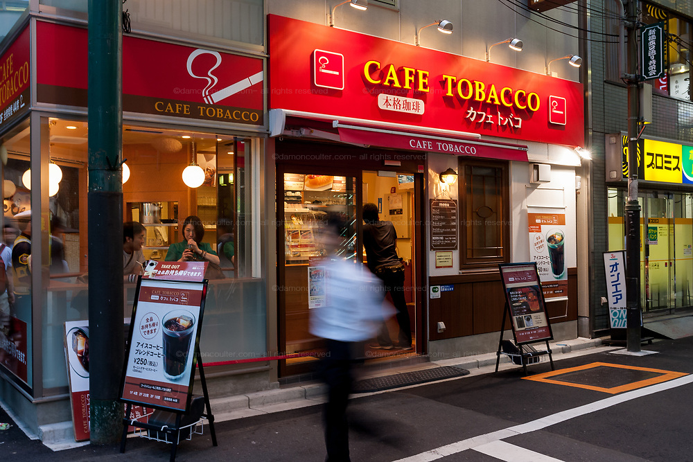 Cafe Tobacco, operated by Towa Food service Co,. in Shimbashi opened in April 2009 as a smokers only cafe after many other bars and public spaces banned smoking. Shimbashi, Tokyo, Japan. Friday, August 14th 2009