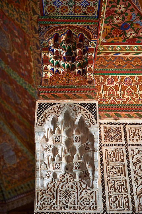 Berber Arabesque Mocarabe plasterwork pamnels and  Muqarnas capitals and painted wood roof.The Petite Court, Bahia Palace, Marrakesh, Morroco .<br /> <br /> Visit our MOROCCO HISTORIC PLAXES PHOTO COLLECTIONS for more   photos  to download or buy as prints https://funkystock.photoshelter.com/gallery-collection/Morocco-Pictures-Photos-and-Images/C0000ds6t1_cvhPo<br /> .<br /> <br /> Visit our ISLAMIC HISTORICAL PLACES PHOTO COLLECTIONS for more photos to download or buy as wall art prints https://funkystock.photoshelter.com/gallery-collection/Islam-Islamic-Historic-Places-Architecture-Pictures-Images-of/C0000n7SGOHt9XWI