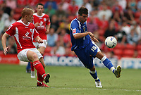 Photo: Rich Eaton.<br /> <br /> Barnsley v Cardiff City. Coca Cola Championship.<br /> <br /> 05/08/2006. Cardiff goalscorer Joe Ledley takes on the Barnsley middield