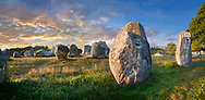 View of Carnac neolthic standing stones monaliths, Alignements du Kermario, a pre-Celtic site of standing stomes used from 4500 to 2000 BC,<br /> <br /> Carnac is famous as the site of more than 10,000 Neolithic standing stones, also known as menhirs. The stones were hewn from local rock and erected by the pre-Celtic people of Brittany. The Carnac stones were erected during the Neolithic period which lasted from around 4500 BC until 2000 BC. One interpretation of the site is that successive generations visited the site to erect a stone in honour of their ancestors. '<br /> <br /> Visit our PREHISTORIC PLACES PHOTO COLLECTIONS for more  photos to download or buy as prints https://funkystock.photoshelter.com/gallery-collection/Prehistoric-Neolithic-Sites-Art-Artefacts-Pictures-Photos/C0000tfxw63zrUT4
