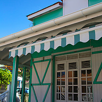 France, Guadeloupe, Les Saintes. Typical red-roofed and shuttered building of Bourg de Saintes, Guadeloupe, in the Caribbean.