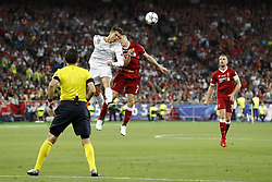 (L-R) Cristiano Ronaldo of Real Madrid, James Milner of Liverpool FC, Jordan Henderson of Liverpool FC during the UEFA Champions League final between Real Madrid and Liverpool on May 26, 2018 at NSC Olimpiyskiy Stadium in Kyiv, Ukraine