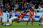 Castleford Tigers replacement Matt Cook (18) off loads the ball in the tackle during the Betfred Super League match between Castleford Tigers and Widnes Vikings at the Jungle, Castleford, United Kingdom on 11 February 2018. Picture by Simon Davies.