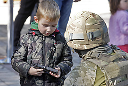 October 6, 2018 - Kiev, Kiev, Ukraine - A kid seen holding a guns during the festival..City of Professions is a children career-oriented festival that provides children with the opportunity to try themselves in different professions like policemen, doctors, social workers, bankers, criminologists, builders, rescuers, firemen, canine experts, bomb experts, and others professions. (Credit Image: © Pavlo Gonchar/SOPA Images via ZUMA Wire)