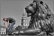 SERIES - DAY-TRIPPER by Paul Williams - Day Tripper - London Trafalgar Square is a selective colour street photography series by photographer Paul Williams  of tourists posing for photos, London taken in 2008 . .<br /> <br /> Visit our REPORTAGE & STREET PEOPLE PHOTO ART PRINT COLLECTIONS for more wall art photos to browse https://funkystock.photoshelter.com/gallery-collection/People-Photo-art-Prints-by-Photographer-Paul-Williams/C0000g1LA1LacMD8