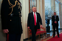 U.S. President Donald Trump stops by the National Governors Association meeting in the State Dining Room of the White House, Washington, DC, February 27, 2017. (Pool / Aude Guerrucci)