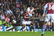 Tottenham's Erik Lamela looks to get a shot at goal past Villa's  Yacouba Sylla. Capital one cup 3rd round match, Aston Villa v Tottenham Hotspur at Villa Park in Birmingham on Tuesday 24th Sept 2013. pic by Andrew Orchard, Andrew Orchard sports photography.