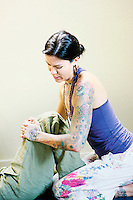 Thai yoga therapist working on her client .