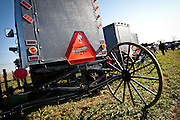 Amish buggy with a bumper stick during the Annual Mud Sale to support the Fire Department  in Gordonville, PA.