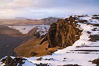 Tourist on top of Dyrhólaey Peninsula, enjoying the sunset. South Iceland.