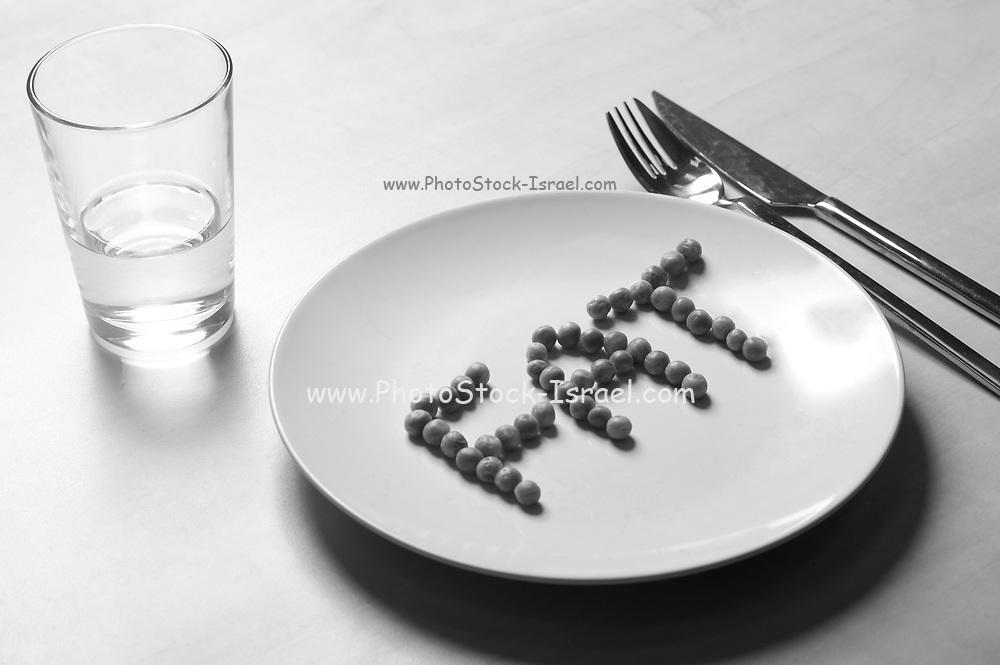 Anorexia. FAT spelt out with peas on a plate.