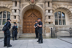 © Licensed to London News Pictures. 09/06/2020. Oxford, UK. Police guard the front entrance to Oriel College at Oxford University, where a demo will be held later by campaigners are calling for the removal of a statue of controversial imperialist Cecil Rhodes. Black Lives Matter protesters recently pulled down a statue of slave trader Edward Colston in nearby Bristol Town centre, following the death of George Floyd in the U.S.A . Photo credit: Ben Cawthra/LNP