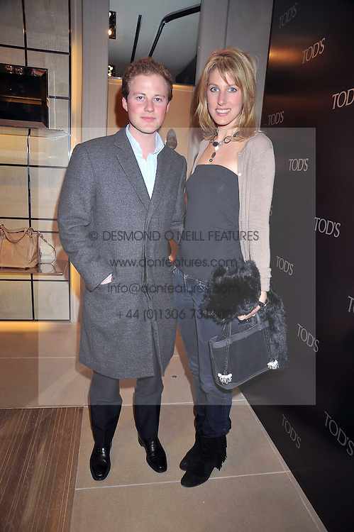 GUY PELLY and SUSANNA WARREN at a party hosted by TOD's to celebrate the launch of the J.P.Loafer collection, held at the TOD's Boutique, 2-5 Old Bond Street, London on 31st March 2009.