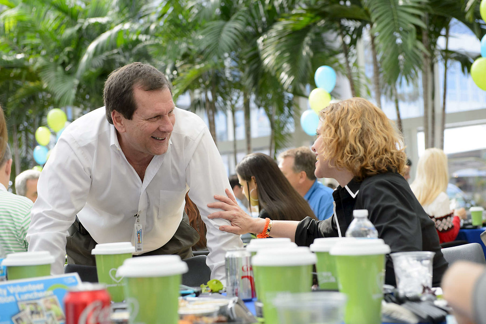 Employees chatting during an appreciation event at a corporate office