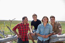 father with three sons outdoors