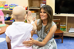 July 24, 2018 - Nashville, Tennessee, U.S. - First Lady MELANIA TRUMP gives a high five to four-year-old Essence Overton during her visit Tuesday, July 24. 2018, to the Monroe Carell Jr. Children's Hospital at Vanderbilt in Nashville. (Credit Image: ? Andrea Hanks/White House via ZUMA Wire/ZUMAPRESS.com)
