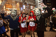 October 29, 2016, Tokyo, Japan: In the Shibuya district, the heart of Japanese youth culture, Halloween celebrations have exploded in the past few years. Up until this boom, Halloween celebrations were minimal across the city. But Shibuya has now become Halloween central with tens of thousands of costumed party goers invading it's streets to promenade en-costume or hit club events in the area. This informal street gathering has become so big, this year the Tokyo Metropolitan Police Dept. decided to close off two main streets adjacent to Shibuya Station. When Oct. 31 falls on a weekday, ninety percent of Halloween celebrations across Japan take place on the preceding Saturday. Pictured here are Little Red Riding Hood and Big Bad Wolf costumes.(Torin Boyd/Polaris).