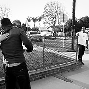 Abner offers condolences and a hug to a stranger who recognized him and asked him to do something for her son who is in prison.
