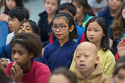 Students listen to comments during a press conference for the Hour of Code at Kolter Elementary School, December 10, 2014.