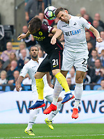 Football - 2016 /2017 Premier League - Swansea City vs Manchester City<br /> <br /> David Silva captain of Manchester City & Angel Rangel of Swansea leap for the ball 		…. at the Liberty Stadium.<br /> <br /> <br /> PIC COLORSPORT/WINSTON BYNORTH