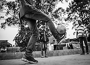 Ceará Machado plays football with his friends in front of the Copa do Povo (People's Cup) Camp in Itaquera, São Paulo. Even if the World Cup is the main reason to be without a roof he still loves the game and will suppport Brazil to lift the cup. The Copa do Povo Camp, is just a few miles from the Arena Corinthians and has 5,000 homeless workers and their families occupied area of fifteen acres. They are homeless after rents skyrocketed because of the World Cup. (Eduardo Leal).