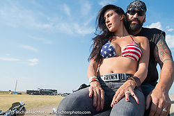 Dawn Pollard with her husband and retired NBA player Scott Pollard (the two make 13' of fun!) watching the arena games for cowboys and bikers at the Spur Creek Ranch for the annual Lichter/Sugar Bear Ride during the 75th Annual Sturgis Black Hills Motorcycle Rally.  SD, USA.  August 5, 2015.  Photography ©2015 Michael Lichter.