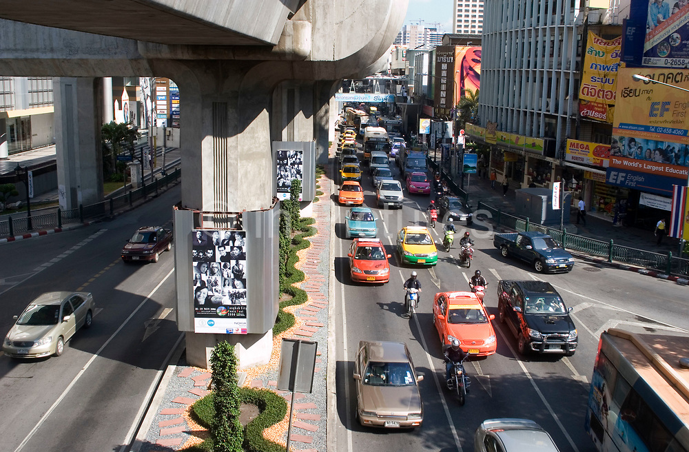 Busy traffic scene near to Siam Square, Bangkok. Although the traffic can be very heavy at times, the air quality seems better than some other bustling Asian cities.