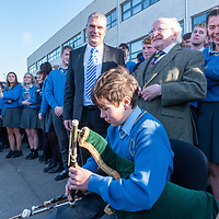President Higgins is welcomed to Kinsale Community School by Principal Fergal McCarthy pupils with piper Fergus Walsh from Belgooly.<br /> Picture. John Allen
