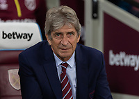 Football - 2018 / 2019 EFL Carabao Cup (League Cup) - Third Round: West Ham United vs. Macclesfield Town<br /> <br /> Manuel Pellegrini, manager of West Ham United,  takes his seat before kick off at The London Stadium<br /> <br /> COLORSPORT/DANIEL BEARHAM