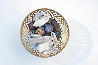 Metal basket filled with magical crystal healing stones.