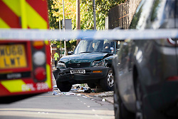 ©️ Licensed to London News Pictures. 08/09/2020. London, UK. Met Police and Fire Brigade dealing with a collision near a Beatrix Potter Primary School in Wandsworth, south west London. A car mounted the pavement and collides with a number of children and two parents. Injuries not life-threatening: one child may have a broken leg. the driver to the car stopped at the scene. Photo credit: Marcin Nowak/LNP