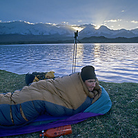 Mark Newcomb (MR) wakes from a bivouac by Lake Karakul in the Pamir Mountains of Xinjiang province in far western China.