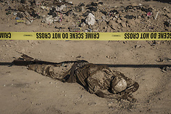 November 19, 2016 - Hammam Al-Alil, Nineveh Governorate, Iraq - A dead body from a mass grave lies in a dump. More than 300 former Iraqi policemen were executed south of Mosul three weeks ago. (Credit Image: © Berci Feher via ZUMA Wire)